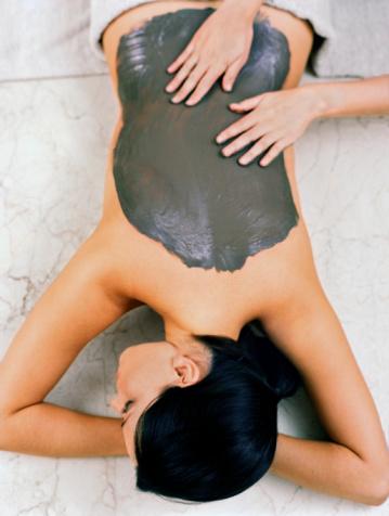 Beautiful woman getting a mud therapy massage